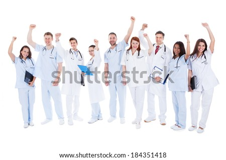Asian female surgeon punches fist into the air isolated on white background Stock photo © bmonteny