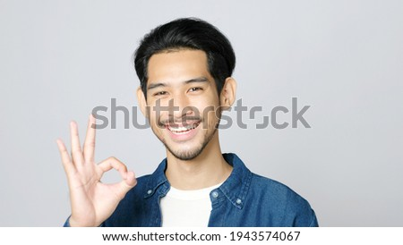 closeup of good looking young man gesturing okay sign over white stock photo © zurijeta