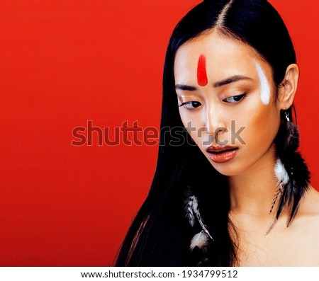 beauty young asian girl with make up like pocahontas red indian stock photo © iordani