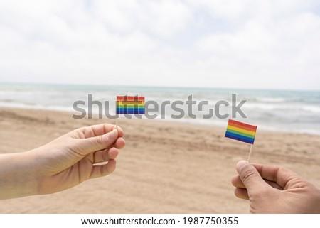 férfi · szivárvány · zászló · óceán · közelkép · fiatal - stock fotó © nito