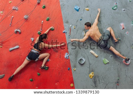 Female trainer instructing women in climbing a rope in the boot camp Stock photo © wavebreak_media