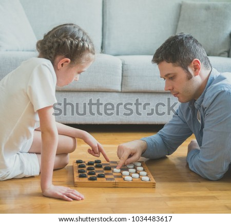 Father and daughter playing checkers Stock photo © IS2