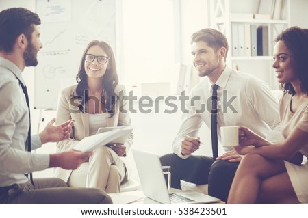 Creative woman sitting on sofa while working on tablet in the office Stock photo © Kzenon