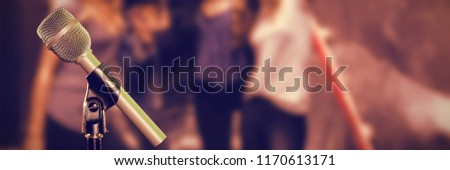 microphone with stand against female friends taking selfie while standing on steps stock photo © wavebreak_media
