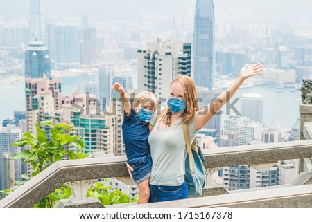 Mom and son travelers at the peak of Victoria against the backdrop of Hong Kong. Traveling with chil Stock photo © galitskaya