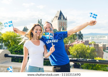 Couple celebrates the national holiday in front of Chateau Frontenac in quebec city Stock photo © Lopolo