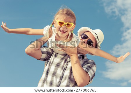 Two little girls are playing at home to travelers with bengal ca Stock photo © dashapetrenko