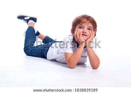 A cute positive five year old boy studio portrait on white background Stock photo © Lopolo