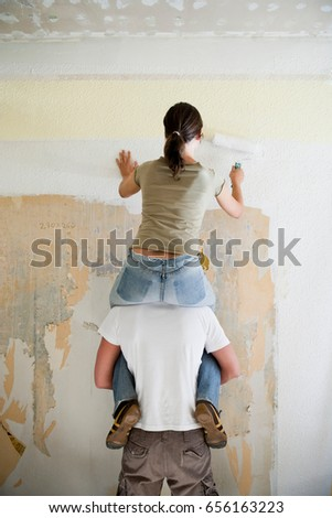 Young women sitting on the men shoulders and holding a basketbal Stock photo © boggy