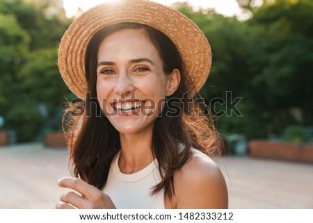 изображение счастливым брюнетка женщину длинные волосы Сток-фото © deandrobot