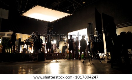 Cinema lights on a commercial video production shoot with lounge zone by the sea Stock photo © galitskaya