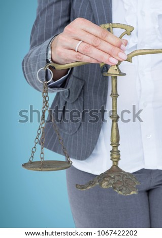 Female judge mid section with scales against blue background Stock photo © wavebreak_media
