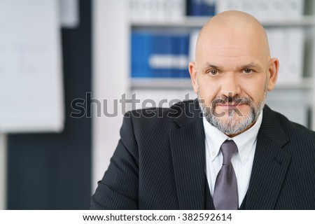 Mid-aged confident businessman in formalwear sitting on stairs Stock photo © pressmaster
