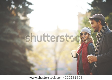 happy lovely young woman drinking outdoor coffee in autumn park stock photo © boggy
