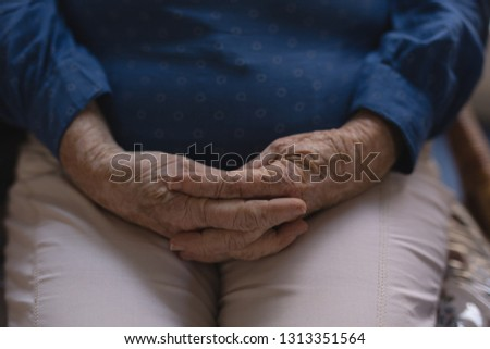 mid section of senior woman with hands clasped at nursing home stock photo © wavebreak_media