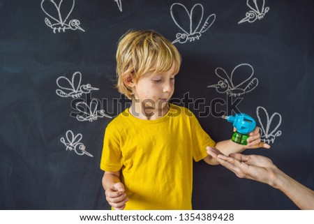 The boy is bitten by mosquitoes holding a fumigator on a dark background. On the blackboard with cha Stock photo © galitskaya