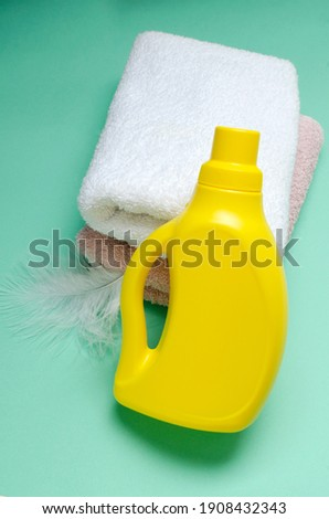 Stack of white soft towels with soft conditioner liquid. White background with copy space for your i Stock photo © vkstudio