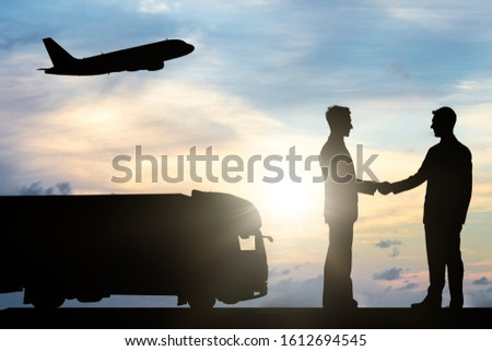 Two Businessmen Shaking Hands Near Truck And Airplane Stock photo © AndreyPopov