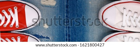 Banner with White and red sneakers on a the ripped denim background. Stock photo © Illia