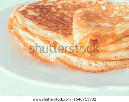 Authentic food, thin homemade pancakes on marble table backgroun Stock photo © Anneleven