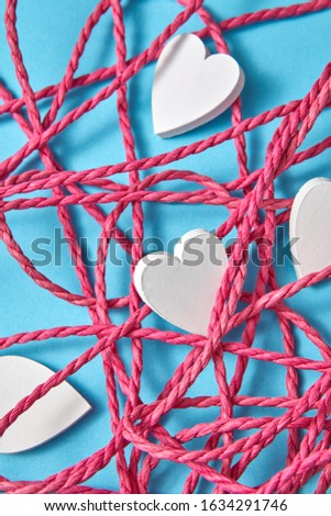 Holiday composition with tangled rope and small hearts. Stock photo © artjazz