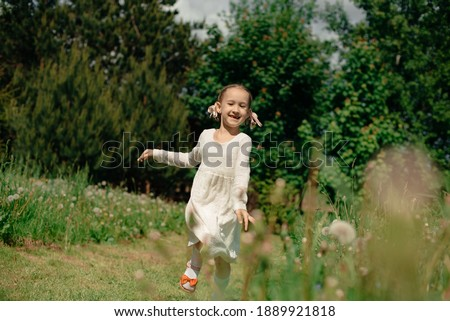 Child girl outdoor walking along the path in the Park near the trees with yellow leaves Stock photo © ElenaBatkova