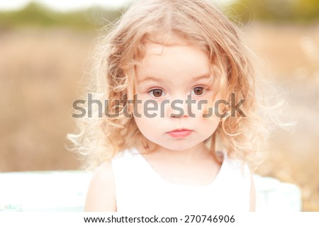 Close-up portrait of a 1-2 year old girl outdoors in a garden with pink flowers in the trees Stock photo © ElenaBatkova