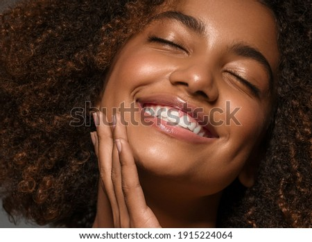 Close up portrait of happy smiling woman with dark curly Afro hairstyle, tilts head, wears optical g Stock photo © vkstudio