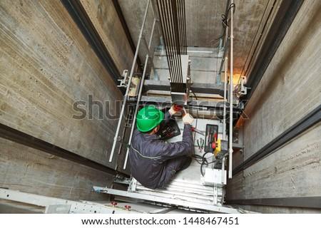 Technician Repairing Elevator Stock photo © AndreyPopov