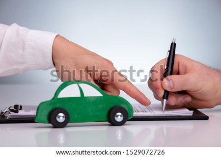 Close-up Of Two Wooden Car On Desk Stock photo © AndreyPopov