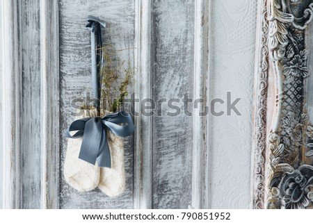 Ancient wooden background decorated with woolen knitted mittens. Handmade. Winter gloves with ribbon Stock photo © vkstudio