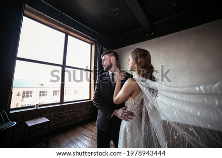 Emotional female bride in white long dress holds wedding bouquet has walk together with male bridegr Stock photo © vkstudio
