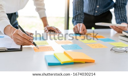 young business workers posting with sticky notes stickers remind Stock photo © snowing