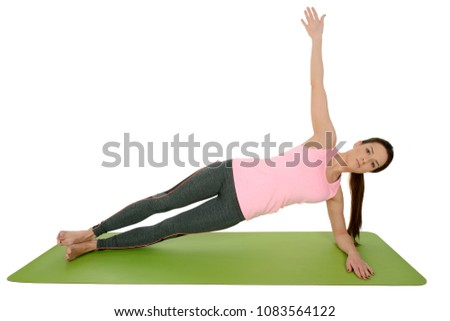 Woman doing yoga asana Vasisthasana - side plank pose outdoors Stock photo © dmitry_rukhlenko
