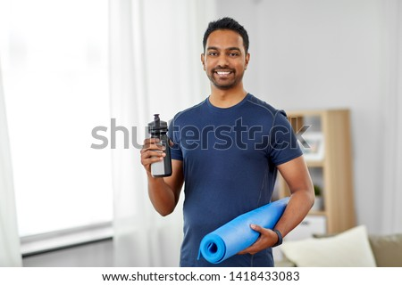 smiling indian man with fitness tracker at home Stock photo © dolgachov