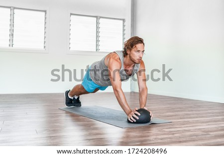 man exercising with fitness ball at home Stock photo © dolgachov