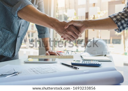 Architect or Engineer meeting working with partner on blueprint  Stock photo © Freedomz