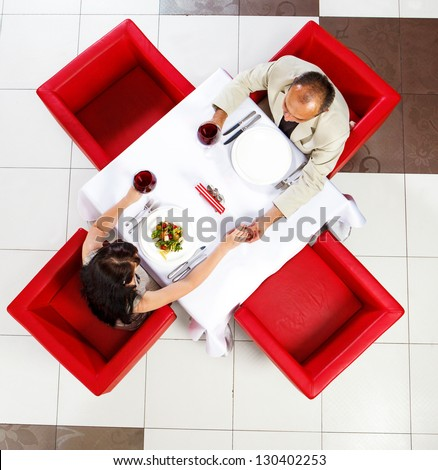 man and woman holding hands in a cozy cafe Stock photo © ruslanshramko