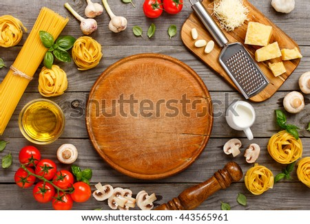 Aceite de oliva tomates cherry tabla de cortar espaguetis pasta romero Foto stock © DenisMArt