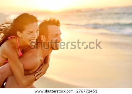 Couple in love having fun piggybacking on Hawaii beach. Healthy people portrait girlfriend and boyfr Stock photo © Maridav