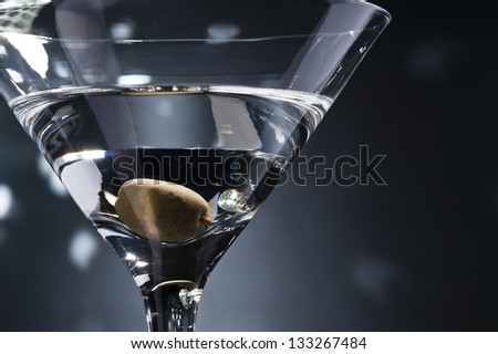 Vodka martini gin cocktail in modern glass with olives on bamboo stickwith fresh green olives on whi Stock photo © DenisMArt