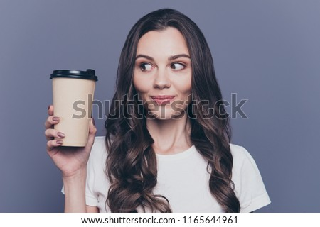 Portrait of nice young woman drinking coffee takeaway and looking aside Stock photo © deandrobot