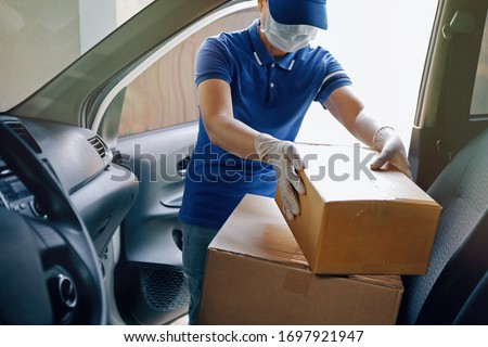 Woman hands in medical protective gloves hold package with purchases Stock photo © galitskaya