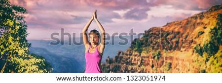 Yoga retreat in Kauai nature panoramic banner. Asian girl practicing meditation outdoors in sunset s Stock photo © Maridav