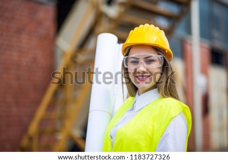 young architect woman wearing a protective helmet standing on th stock photo © hasloo