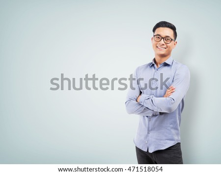 Young handsome businessperson posing Stock photo © stockyimages