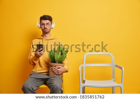 teenager wearing hoodie against yellow background holding spray Stock photo © photography33