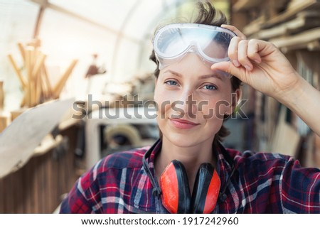 portrait of carpenter with protective goggles looking horrified Stock photo © photography33