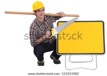 carpenter holding plank over shoulder and handsaw Stock photo © photography33