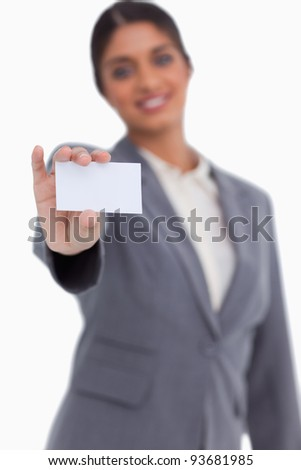 Stock photo: Saleswoman showing blank business card against a white background